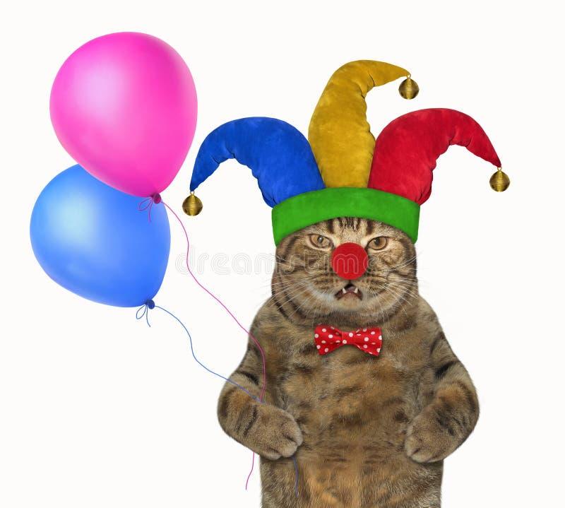 Kat in een narrenhoed met ballons stock foto's