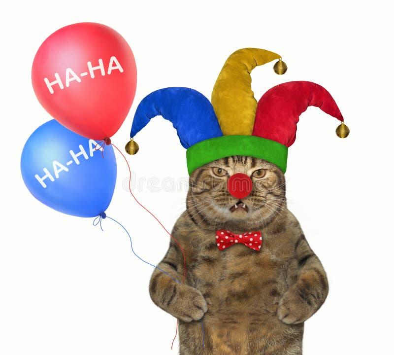 Kat in een narrenhoed met ballons 2 royalty-vrije stock foto's