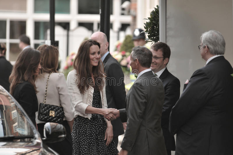 Kate Middleton arrives at the Goring Hotel royalty free stock photography