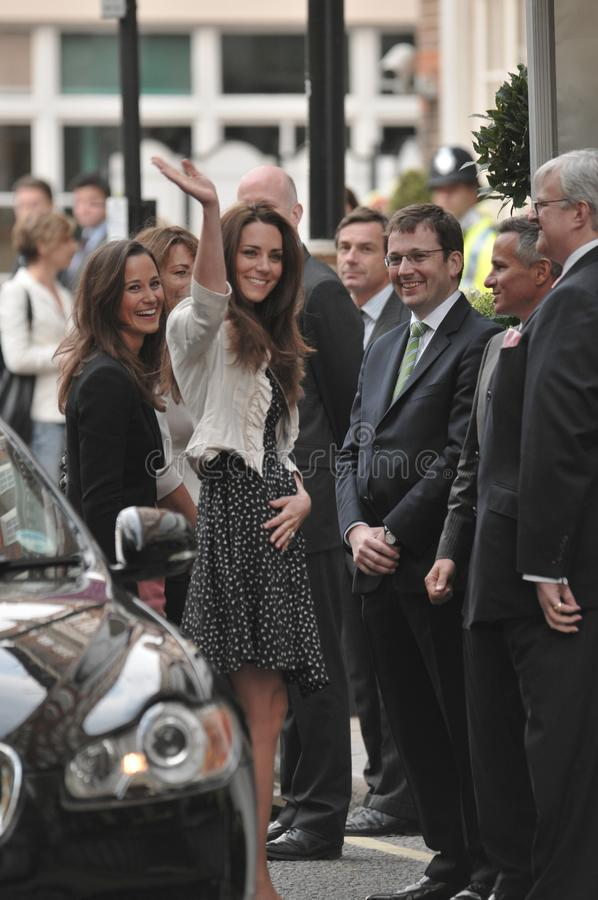 Kate Middleton arrives at the Goring Hotel. On the evening before her wedding to Prince William royalty free stock images