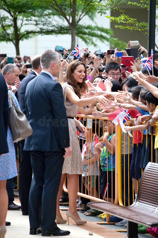 Kate Middleton and Prince William meeting well wishers, Singapore Sept 12 2012. SINGAPORE, September 12 - Princess Kate Middleton meeting her well wishers at stock photos