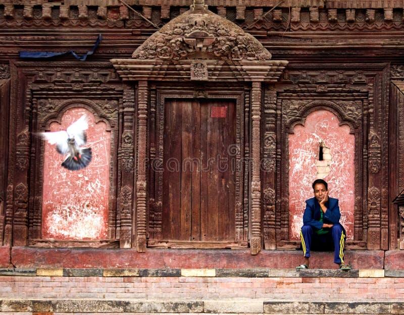 Kathmandu Durbar Square, Nepal. Man siting near the temple in Kathmandu Durbar Square, Nepal