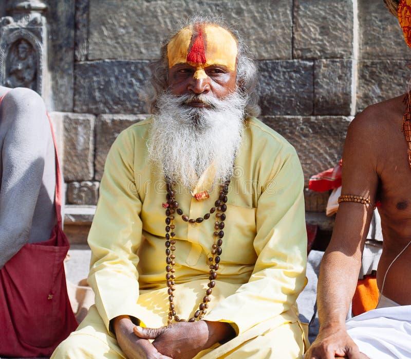 KATHMANDU - FEBRUARY 17: Sadhu at Pashupatinath Temple in Kathmandu, Nepal on Feb 17, 2017. Sadhus are holy men who have chosen to live an ascetic life and royalty free stock photos