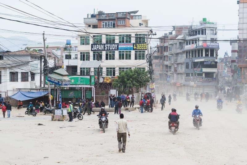 KATHMANDU, NEPAL - APRIL 2015: people walking and driving on the street stock photography