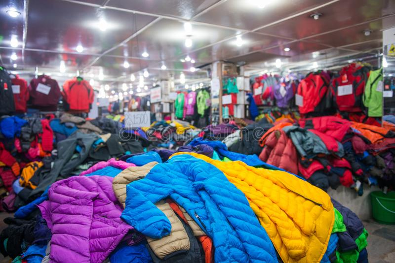 Kathmandu, Nepal - April 19, 2018 :Wear and trekking equipment f. Or sell in Thamel street at Kathmandu, Nepal stock photos