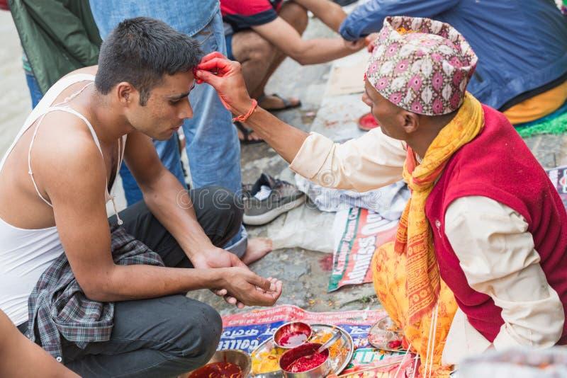 Hindu Pople Receiving Raksha Bandhan at Pashupatinath Temple in royalty free stock images