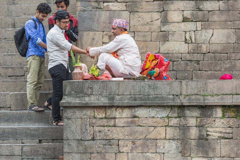 Hindu Pople Receiving Raksha Bandhan at Pashupatinath Temple in stock photography