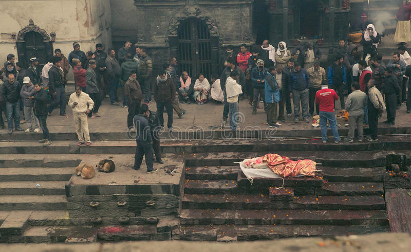 Kathmandu, Nepal - Jan 01,2017: The moment of the family member burning in the holy fire and then in holy river Bagmati. royalty free stock photo
