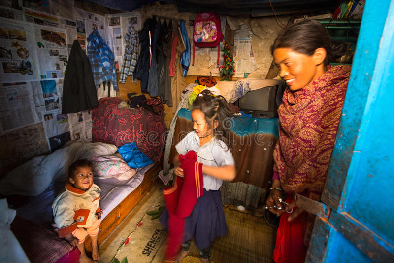 KATHMANDU, NEPAL - local people in his house in a poor area of the city. stock photo