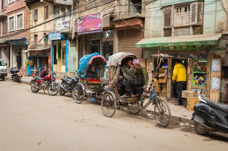 KATHMANDU, NEPAL-MARCH 16: The streets of Kathmandu on March 16, 2015 in Kathmandu, Nepal. Street life in the capital of Nepal. stock photos