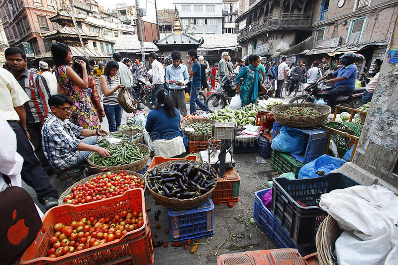 KATHMANDU,NEPAL-MAY 11, 2014: Local people shopping for groceries in Asan Tol market. Asan Tol or Ason Tole market place is one of the oldest and the most royalty free stock photography