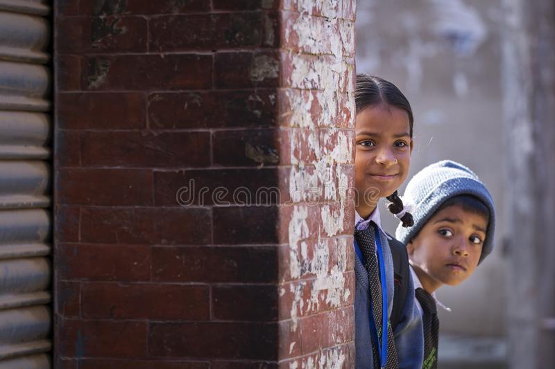 Kathmandu, Nepal - November 10, 2017 - Children coming back from. School in streets of Kathmandu, Nepal royalty free stock images