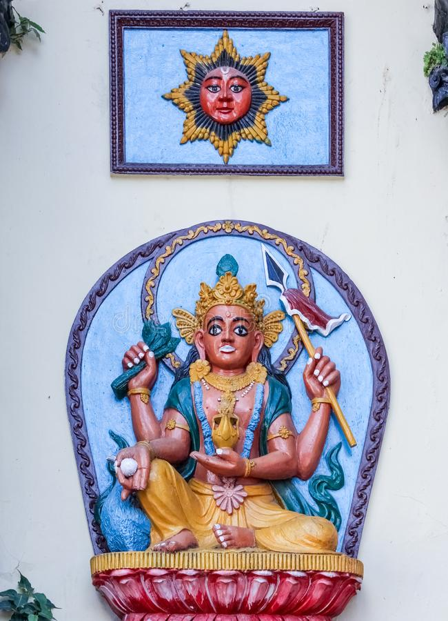 Kathmandu, Nepal - November 02, 2016: Hindu God and sun reliefs on a white wall in a temple, Nepal stock photography