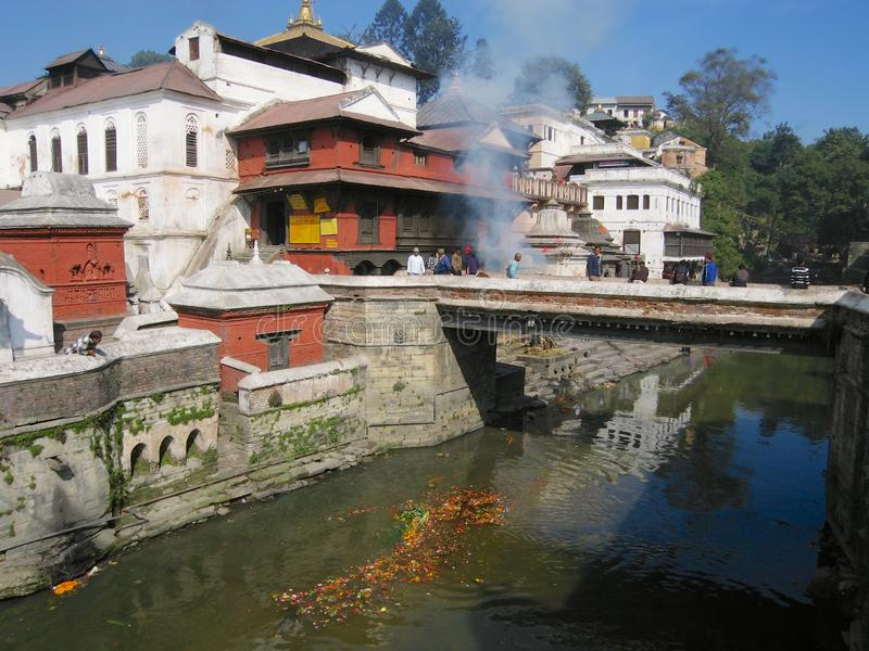 Hindu temple of Pashupatinath, seen from across the Bagmati river where traditional cremations take place, in Kathmandu, Nepal. stock photography