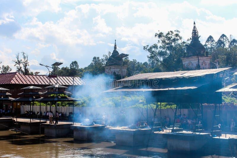 Kathmandu, Nepal - November 02, 2016: Preparation to cremation ceremony along the holy Bagmati River at Pashupatinath Temple royalty free stock photos