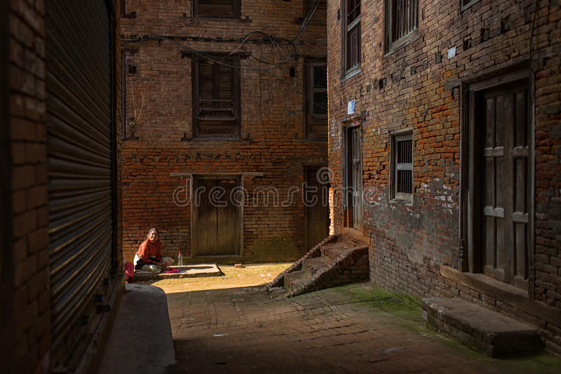 KATHMANDU, NEPAL - NOVEMBER 30: Unkown woman staying on street of Kathmandu on November 30, 2014. In KATHMANDU, Nepal royalty free stock photos