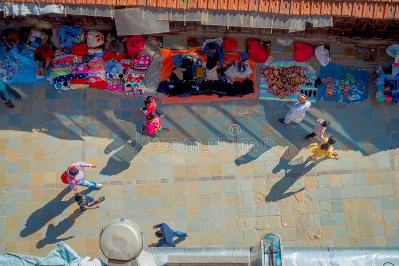 KATHMANDU, NEPAL OCTOBER 15, 2017: Above view of of unidentified people walking in a busy shopping street with colorful stock photos