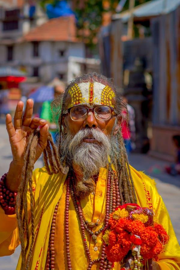 KATHMANDU, NEPAL OCTOBER 15, 2017: Portrait of Nepalese sadhu man holding in his hands a prayer beads on the street of. Kathmandu square in Nepal stock photos