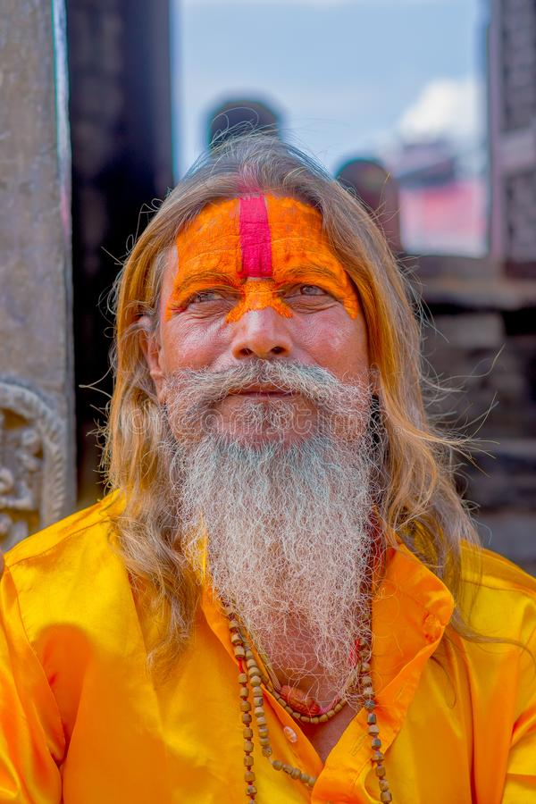 KATHMANDU, NEPAL OCTOBER 15, 2017: Portrait of Shaiva sadhu with white beard, holy man in Pashupatinath Temple with stock photo