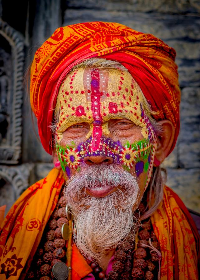 KATHMANDU, NEPAL OCTOBER 15, 2017: Portrait of Shaiva sadhu with white beard, holy man in Pashupatinath Temple with. Painted face, with prayer beads arounds his stock photo