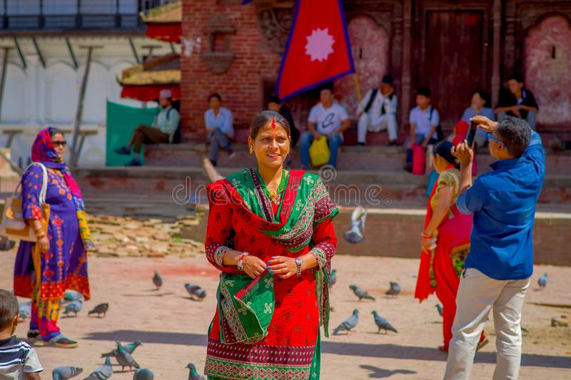 KATHMANDU, NEPAL OCTOBER 15, 2017: Unidentified nepalese woman wearing typical clothes posing for camera, in a Durbar. Square in a beautidul sunny day near old royalty free stock images