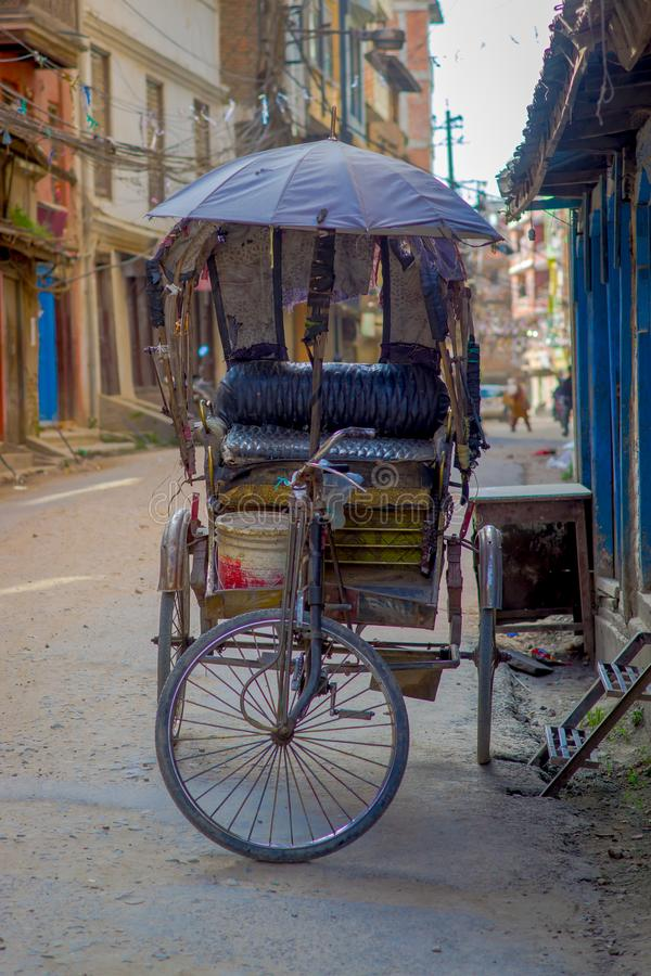 KATHMANDU, NEPAL OCTOBER 15, 2017: Unidentified people in rickshaw in historic center of city, in Kathmandu, Nepal stock photography