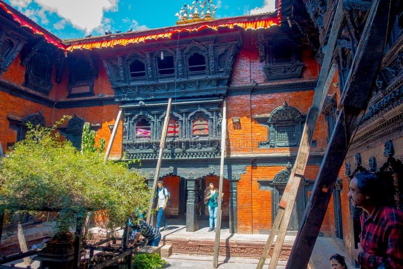 KATHMANDU, NEPAL OCTOBER 10, 2017: Unidentified people walking in front of the Kumari Ghar, built in 1757 in Kathmandu stock photography