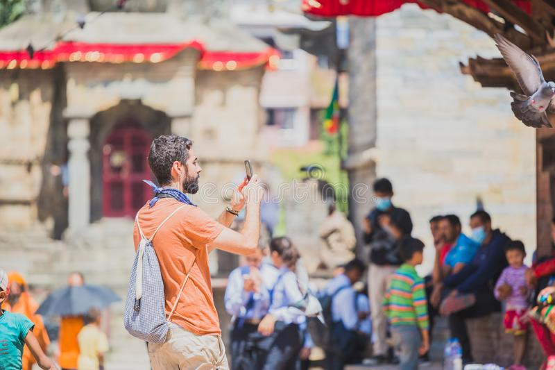 Foreign Tourist Photographer Taking Pictures in Kathmandu,Taking photos. Kathmandu,Nepal - Sep 24,2018:Foreign Tourist photographer taking photos in Kathmandu stock images