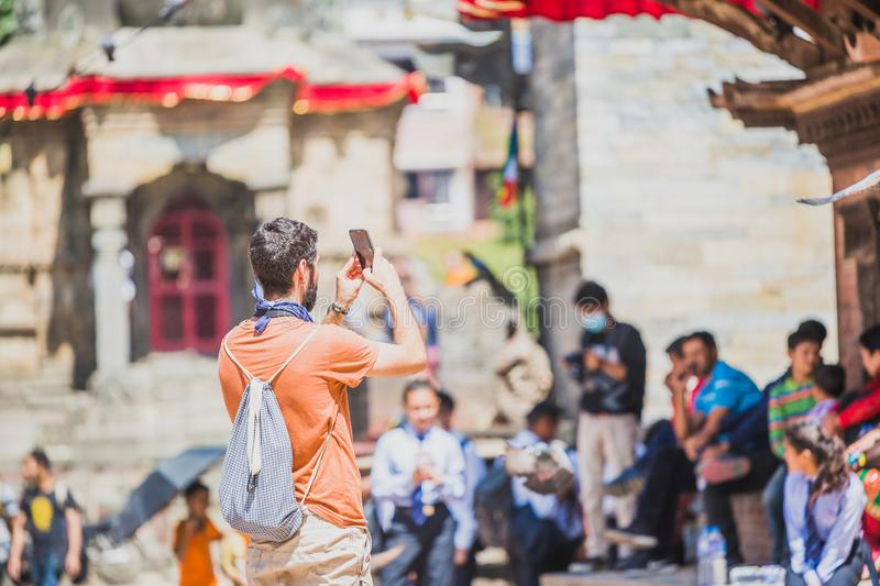 Foreign Tourist Photographer Taking Pictures in Kathmandu,Taking photos. Kathmandu,Nepal - Sep 24,2018:Foreign Tourist photographer taking photos in Kathmandu stock photo