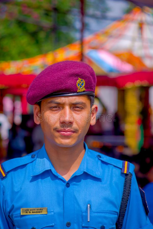 KATHMANDU, NEPAL - SEPTEMBER 04, 2017: Portrait of a Guard from the Nepalese Army posing for camera at the enter of. Bindabasini temple stock photography