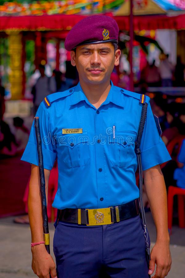 KATHMANDU, NEPAL - SEPTEMBER 04, 2017: Portrait of a Guard from the Nepalese Army posing for camera at the enter of. Bindabasini temple stock image