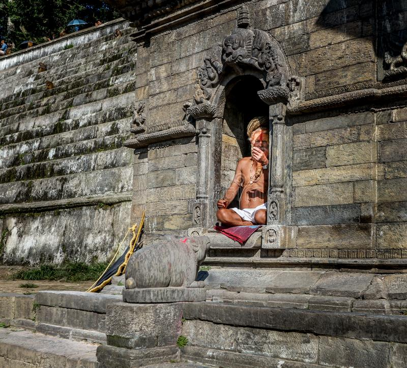 Kathmandu, Nepal - September 21, 2016: Portrait of a holy Sadhu man with painted face in Pashupatinath Temple in Kathmandu, Nepal royalty free stock photo