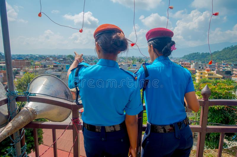 KATHMANDU, NEPAL - SEPTEMBER 04, 2017: Portrait of two women guards giving a back to the camera, from the Nepalese Army. Posing for camera at the enter of royalty free stock images