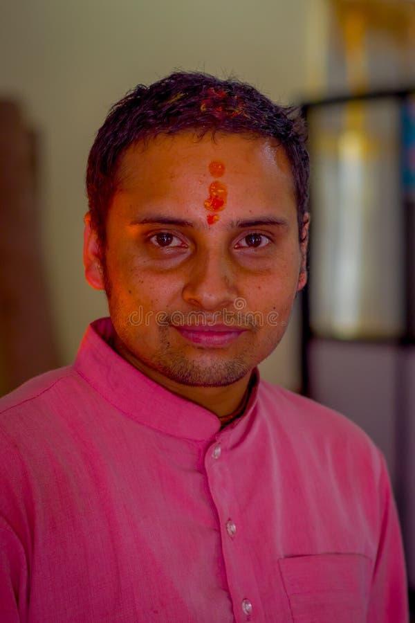 KATHMANDU, NEPAL - SEPTEMBER 04, 2017: Portrait of unidentified Nepalese man in traditional clothes of Kathmandu, Nepal.  royalty free stock photos