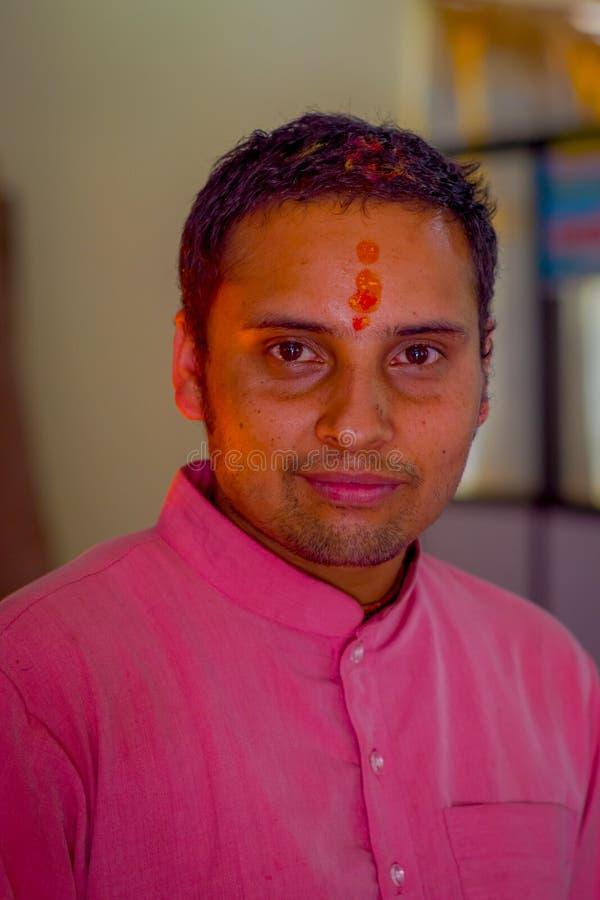KATHMANDU, NEPAL - SEPTEMBER 04, 2017: Portrait of unidentified Nepalese man in traditional clothes of Kathmandu, Nepal.  stock photo