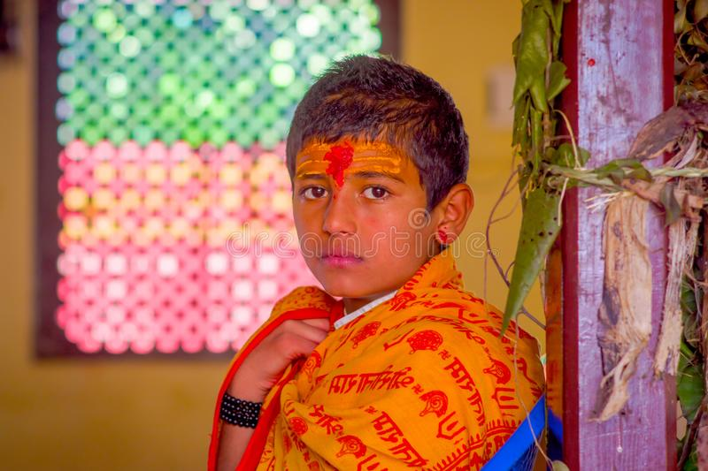 KATHMANDU, NEPAL - SEPTEMBER 04, 2017: Portrait of young Nepalese boy wearing typical clothes and some orange and red. Color in his forehead, in Nepal stock photos