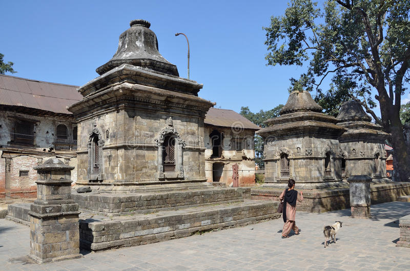 Kathmandu, Nepal, Septenber, 29, 2013, People walking in the temple complex of Pashupatinath stock photography