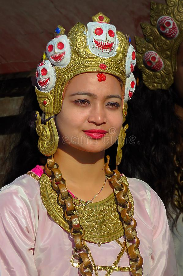 Beautiful woman wearing special jewelry and headdress, Kathmandu, Nepal. Kathmandu, Nepal - 11/21/2017: woman wearing festive clothing and head ornament for a royalty free stock images