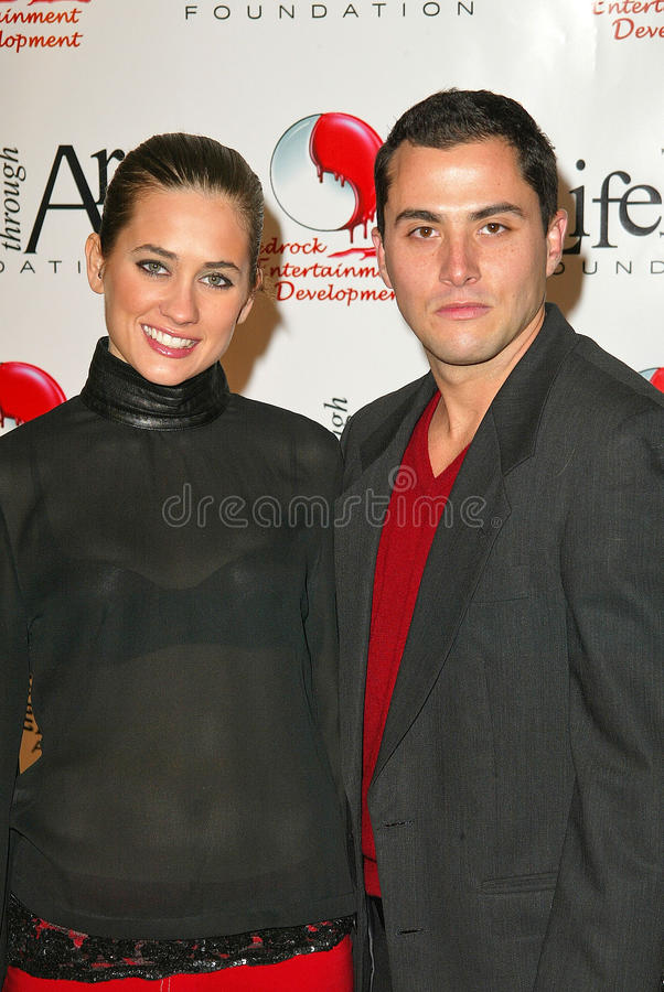 Katie Chonacas,Jose Antonio. Katie Chonacas and Jose Antonio at the Red Party to Benefit the Life Through Art Foundation, hosted by the cast of 8 Simple Rules royalty free stock images