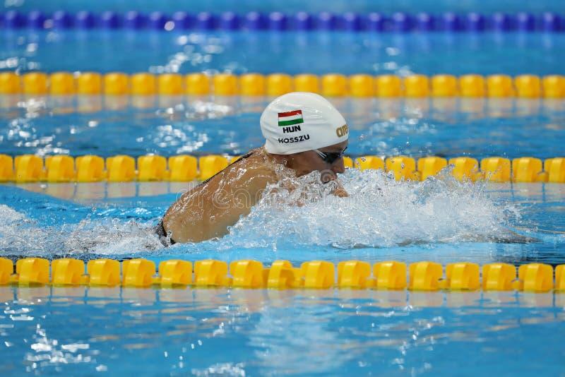 Katinka Hosszu de Hungría celebra el oro que gana en el final de la espalda del 100m de las mujeres de la Río 2016 Juegos Olímpic foto de archivo libre de regalías