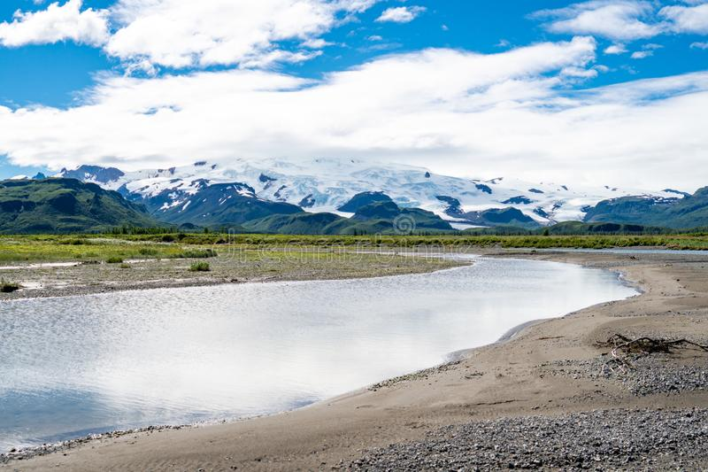 Katmai National Park with river, beach, sand and mountains stock image