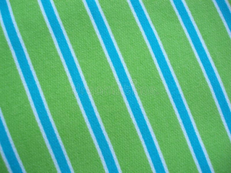 Katoenen stof met blauwgroene en witte strepen stock foto