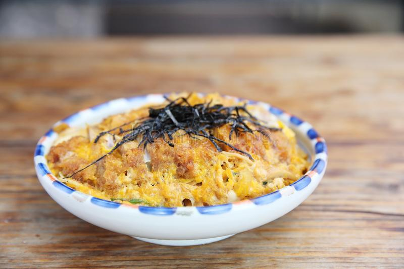 Katsudon deep fried pork cutlet with egg on rice stock image