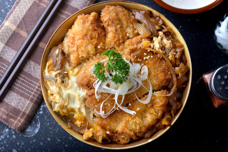 Katsudon or Japanese style fried pork roast . Katsudon or Japanese style fried pork roast with eeg and Japanese ingredient mixed on rice ready to serve in royalty free stock photography