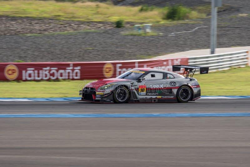 Katsumasa Chiyo van GAINER in Super Definitieve Race 66 van GT Overlappingen bij 2015 royalty-vrije stock foto's