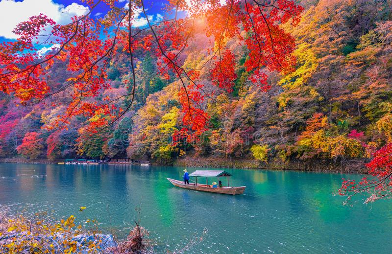 Katsura River with Boatman punting the boat for tourist in kyoto Japan.  royalty free stock image