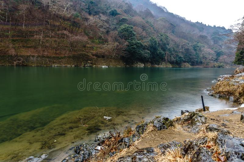 Katsura River in Winter. KYOTO, JAPAN - FEB 10, 2018 : Katsura River in Winter with Mountain in Background Arashiyama, Kyoto, Japan stock images