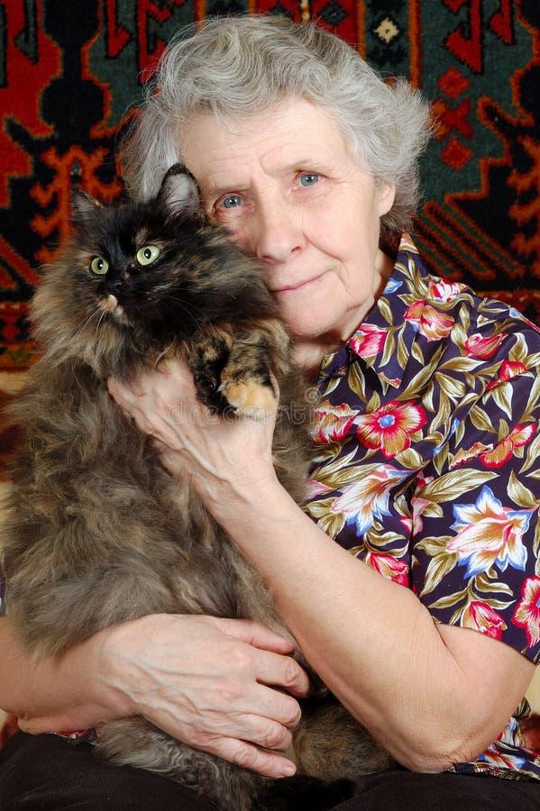 kattfarmodern hands henne som sitter royaltyfria foton