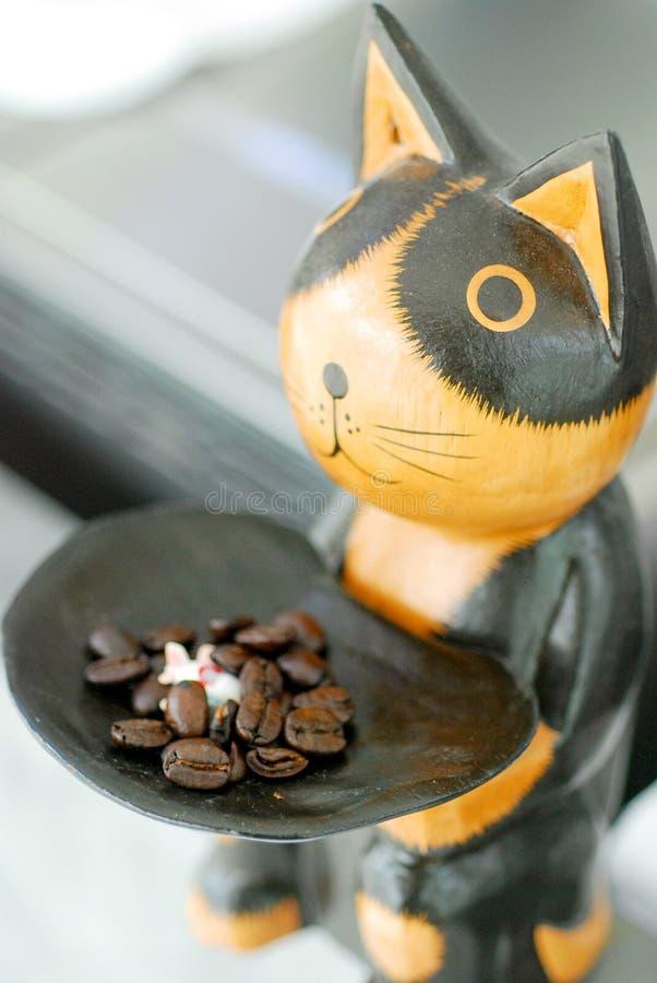 Kattstaty och bönakaffe royaltyfri foto