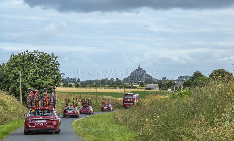 Katusha Team Caravan - Tour de France 2016. Ardevon, France - July 2, 2016: The cars of the cycling team Katusha driving to the start of the Tour de France near royalty free stock image